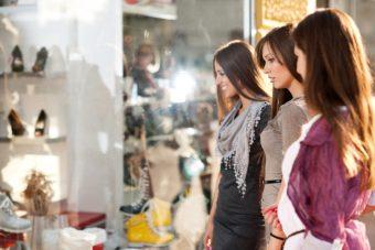 Cheerful friends shopping in the mall.    [url=http://www.istockphoto.com/search/lightbox/9786738][img]http://dl.dropbox.com/u/40117171/group.jpg[/img][/url]