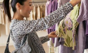 Woman looking at clothes --- Image by � Stuart O'Sullivan/Corbis