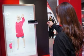 An employee of Chinese tech giant JD.com shows an augmented reality system that allows customers to virtually try on clothing at shops, part of the high-tech retail marketplace at the 2019 Consumer Electronic Show in Las Vegas AFP/Rob Lever