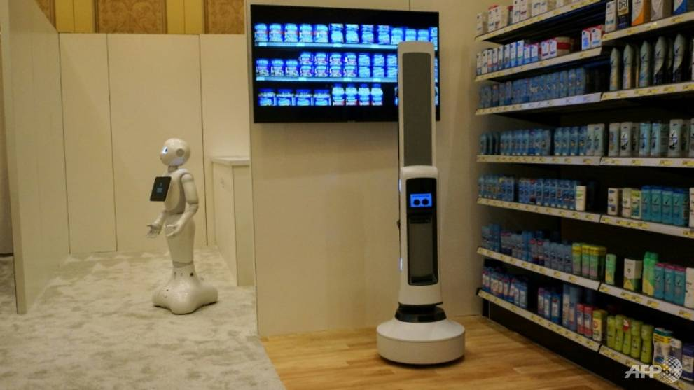 Pepper of SoftBank Robotics (L) and Tally of Simbe Robotics (R) are teaming up to work with retailers: Pepper interacts with customers while Tally scans shelves to monitor inventory in this demo from SoftBank at the Consumer Electronics Show AFP/Robert LEVER